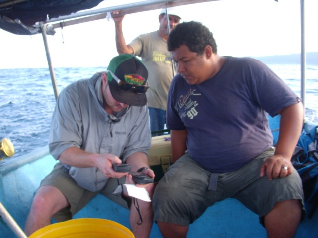 Jon and Jose plug coordinates into the GPS during one of the project's marine survey boat trips in February.